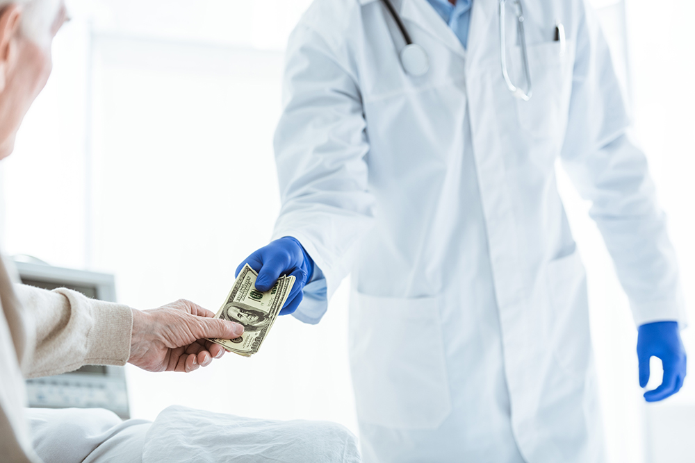 Man Paying Medical Professional